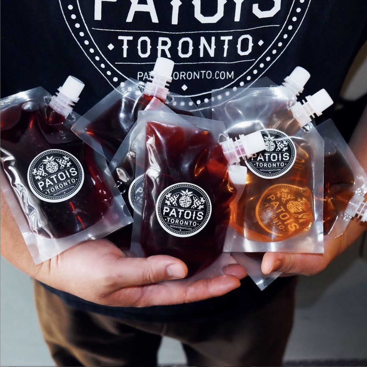 Person holding lots of Patois Cocktails-to-go